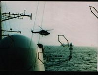 tn_Sea Skua armed Lynx SS Canberra astern